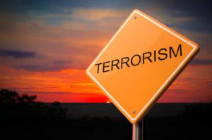 Terrorism Inscription on Warning Road Sign.