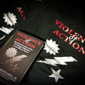 VoA shirt and book