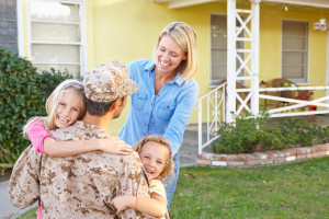 Family Welcoming Husband Home On Army Leave