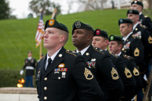 "Special Forces Green Beret soldiers from each of the Army's seven Special Forces Groups stand silent watch during the wreath-laying ceremony at the grave of President John F. Kennedy, Nov. 17, 2011, at Arlington National Cemetery. The ceremony marked a time-honored tradition to honor Kennedy for his support and advocacy of the soldiers who would be known simply as ""Green Berets."""