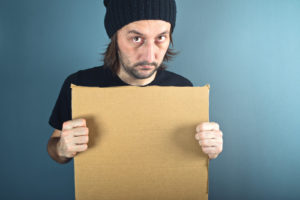 Man holding blank cardboard paper with copy space for your text.