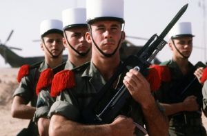 An honor guard from the French army's 6th Battalion stands at attention as they await the arrival of Lt. Gen. Khalid Bin Sultan Bin Abdul Aziz, commander of Joint Forces in Saudi Arabia, during Operation Desert Shield. The soldier in front is holding a 5.56mm FA MAS rifle, equipped with a bayonet.