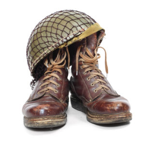 Retro military helmet and boots on a white background.