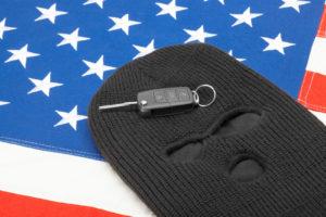 Car keys on black mask and US flag