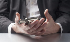 desperate gestures with gun in hands at work