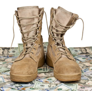 army boots on the background of dollar bills