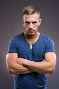 Portrait of masculine tough looking young man with serious expression and pose.