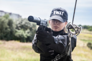 Female police officer SWAT during assault operation
