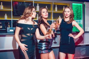 Girls having fun at a party in nightclub