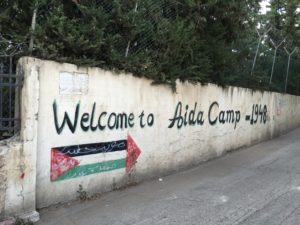 pdli-outside-camp-aida